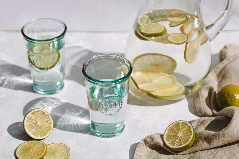glass of cold drink with lime